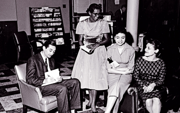 Howard Zinn signs his first book, LaGuardia in Congress, for his Spelman College students in 1960. (Courtesy of the Spelman College Archives)