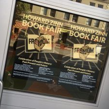 2016 Howard Zinn Book Fair posters in window